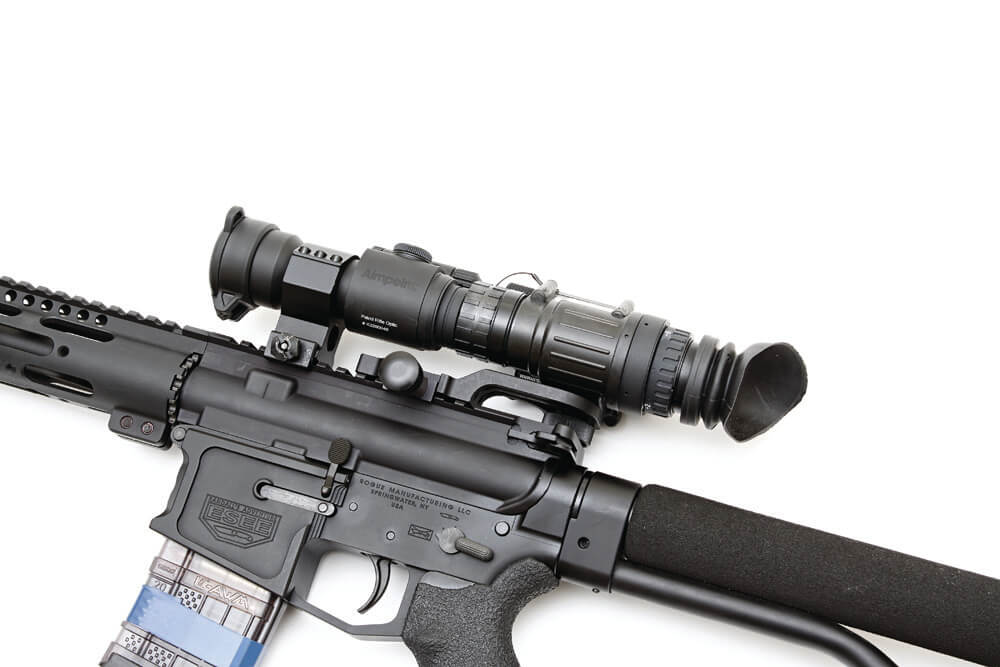 Night vision scope mounted on a rifle, allowing it to be used at night