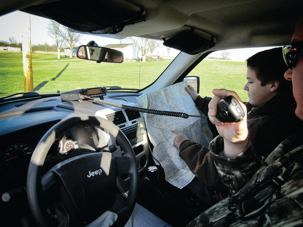 Man in a vehicle communicating via radio