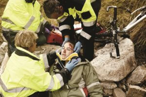 Woman with neck injury is treated by first aid responders.