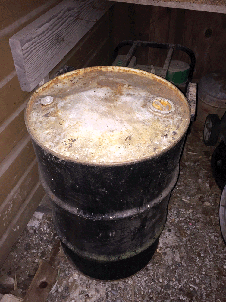 This is a 30-gallon fuel drum that has been in use for several years and should be replaced. You can see where expanding fuel has bent the top of the drum. It's also starting to rust. Almost as important as the fuel inside is what you keep it in.