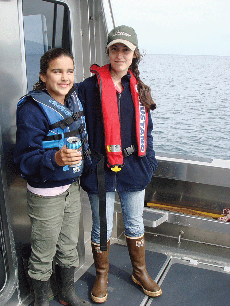 The young lady on the right is wearing a Type II PFD while the one on the right is wearing a manually inflating Type III PFD.
