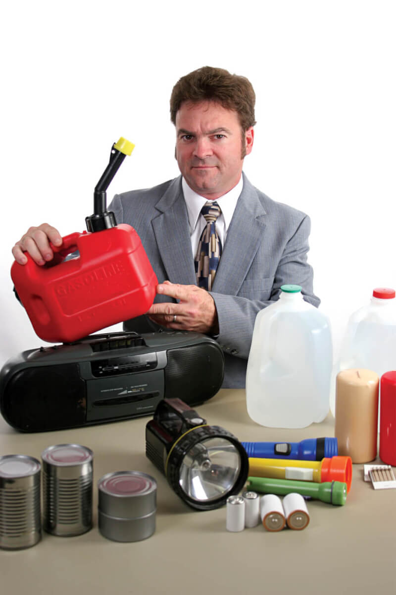 Man with gasoline, water, batteries, and a radio, items helpful when preparing for an earthquake