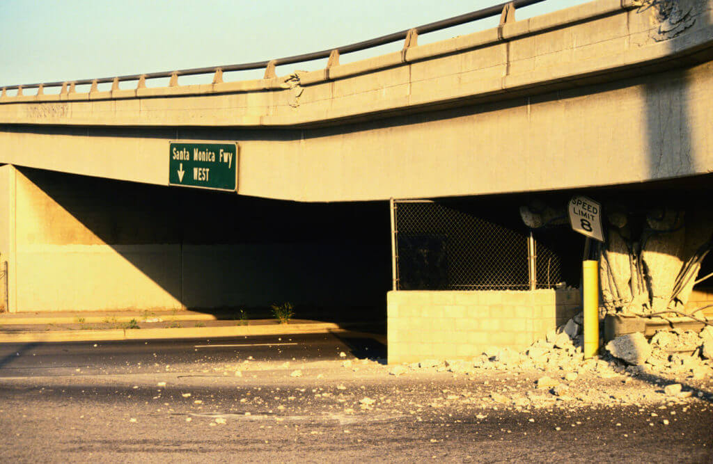 Though common wisdom tells us to take shelter under bridges, the danger of falling debris is obvious.