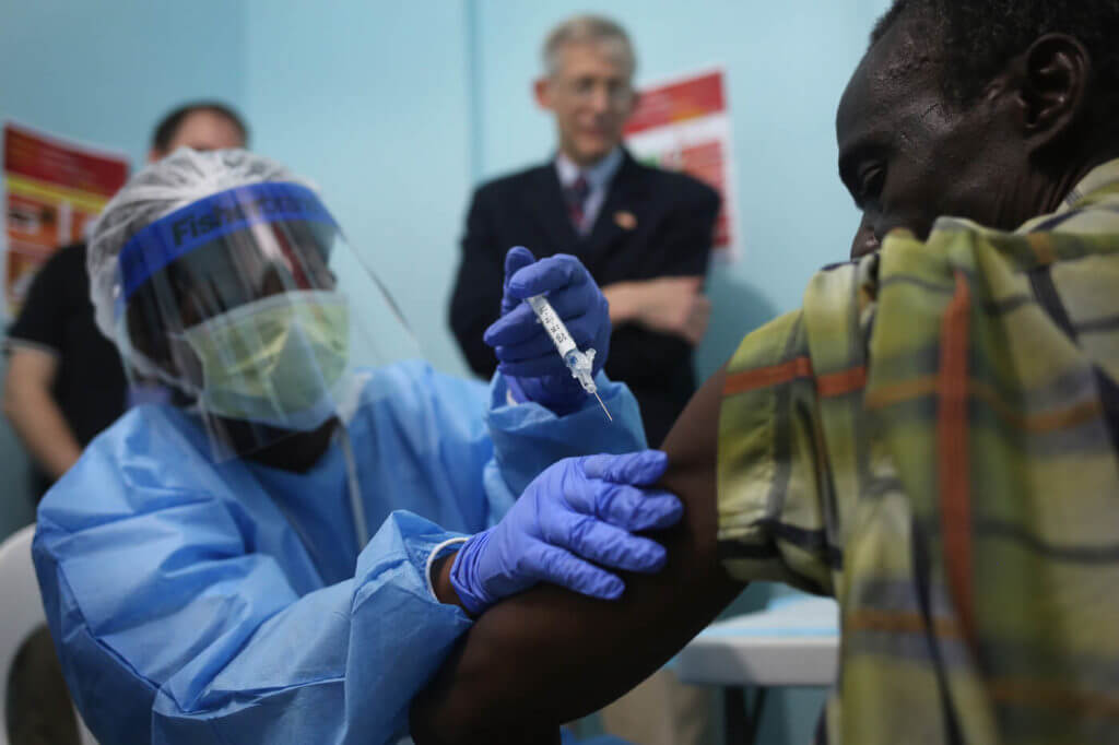 Healthcare workers administer Ebola vaccine to citizens of Liberia in 2015.