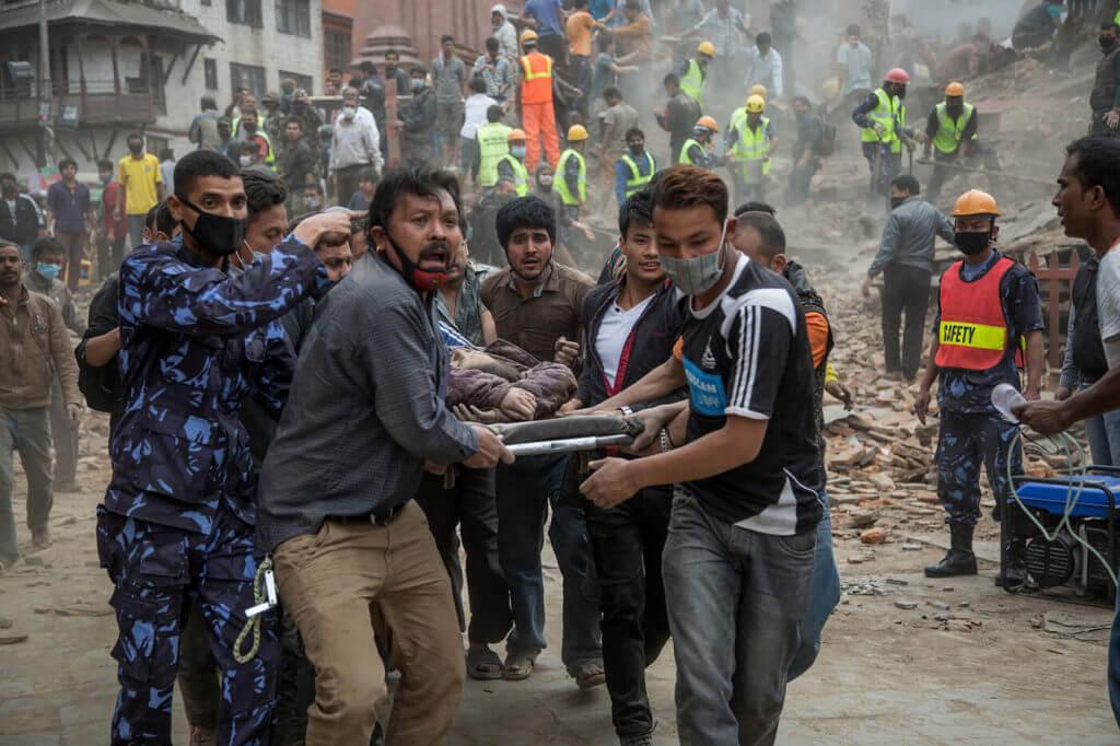 Rescuers help victims of an earthquake in Kathmandu, Nepal