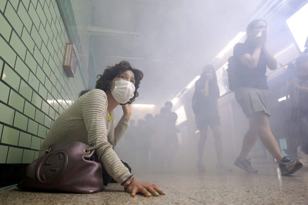 People take part in a training exercise in Seoul, South Korea, simulating a terrorist attack using biological weapons.