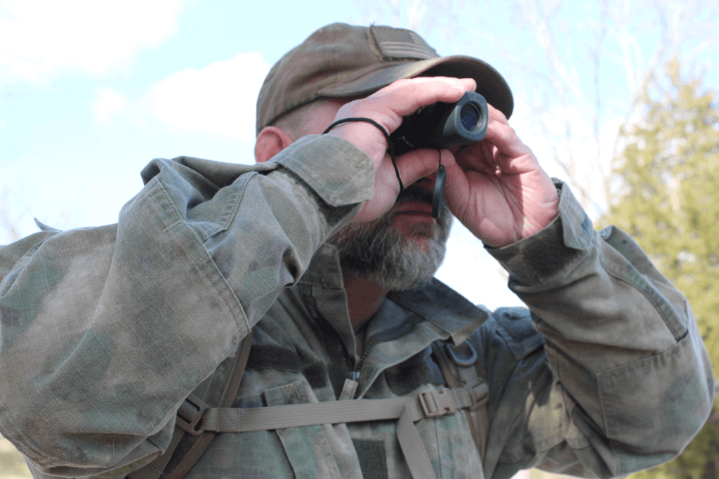 The author uses a monocular to observe the surroundings.