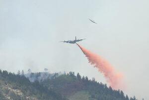 C-130 dropping fire retardant on Waldo Canyon