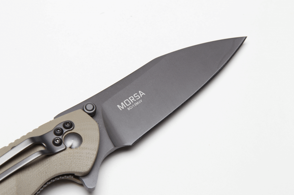 The Morsa has a drop-point blade made from 8Cr13MoV stainless steel, which is strong and keeps a sharp edge.
