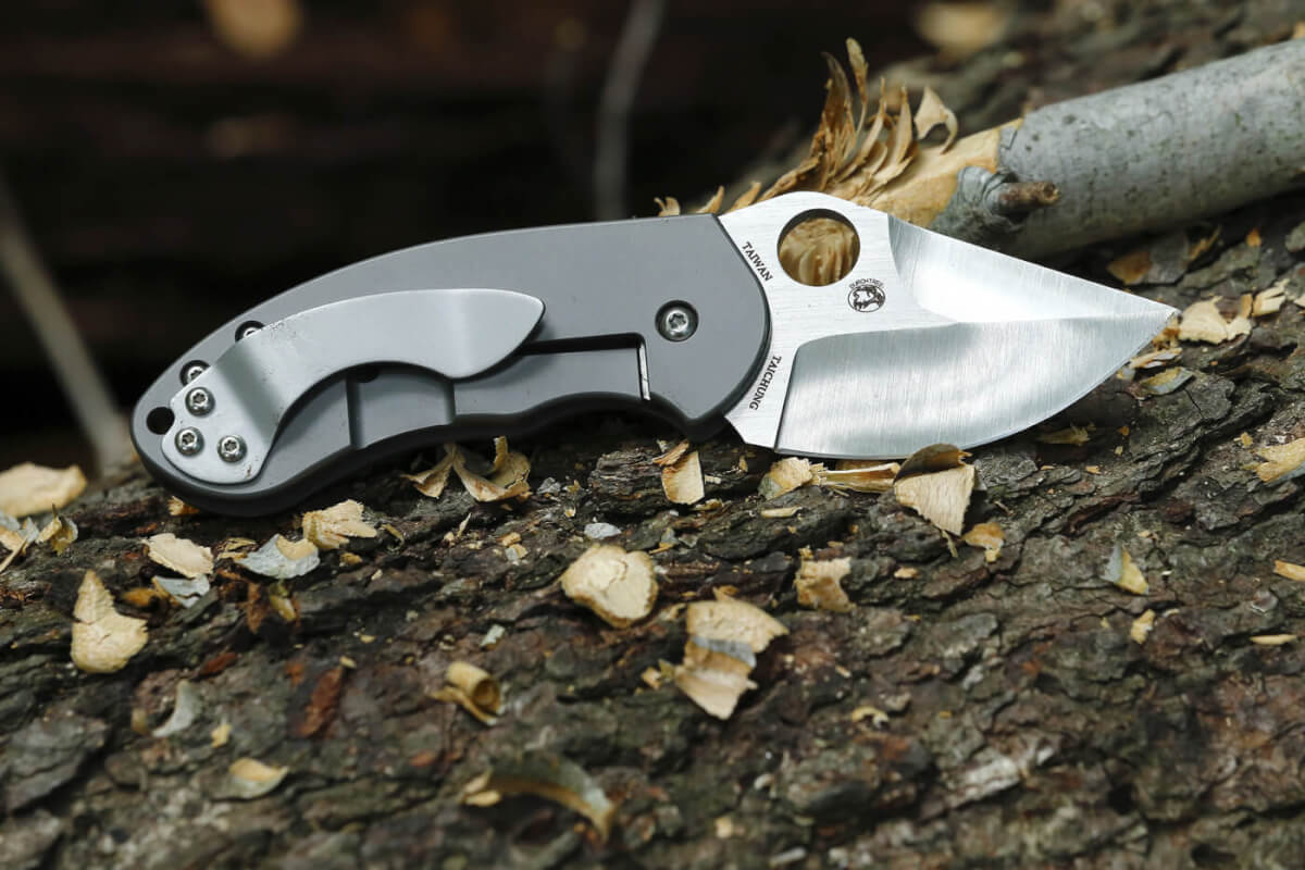 The Burch Chubby folding knife, on top of some wood carved from a tree