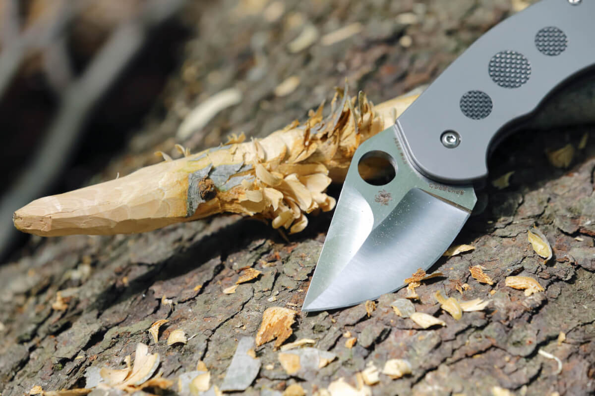 The Burch Chubby folding knife, next to a wooden stake it carved