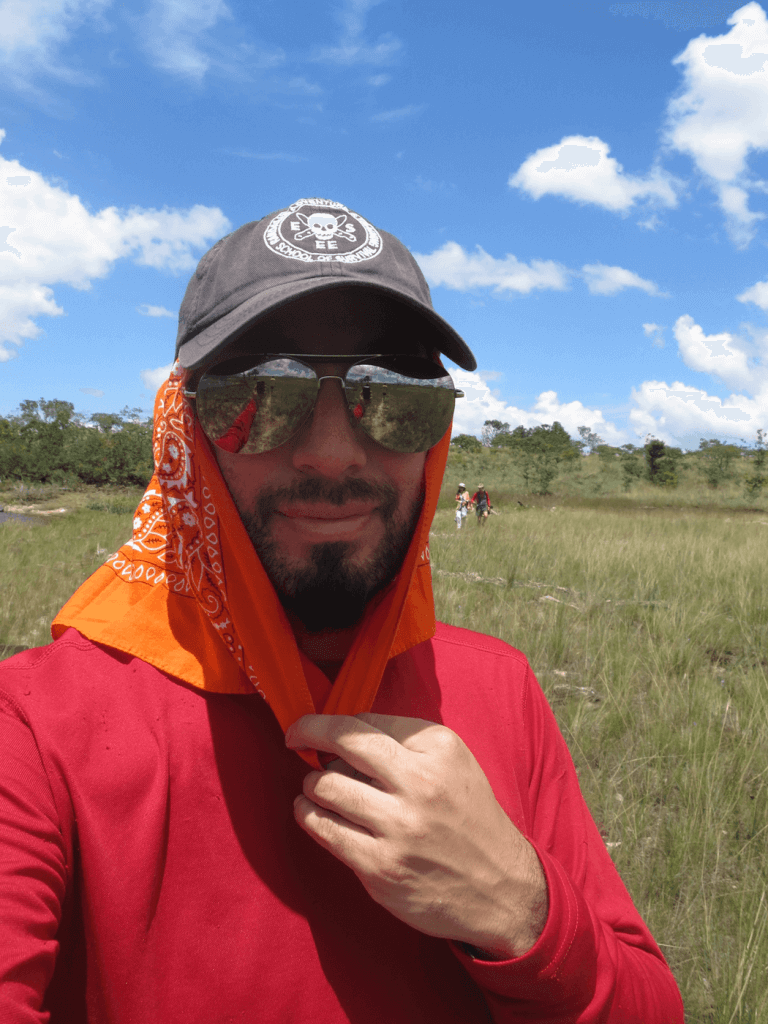 Reuben Bolieu using his protective clothing such as his bandana to protect against the sun
