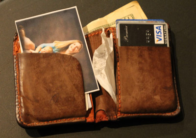A decoy wallet, filled with a small amount of money, as well as fake photos and expired cards