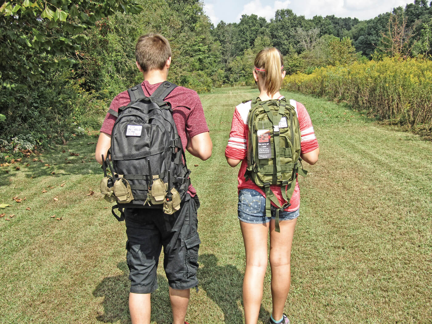 Young boy and girl carrying components for setting up World Gone Silent disaster radio system