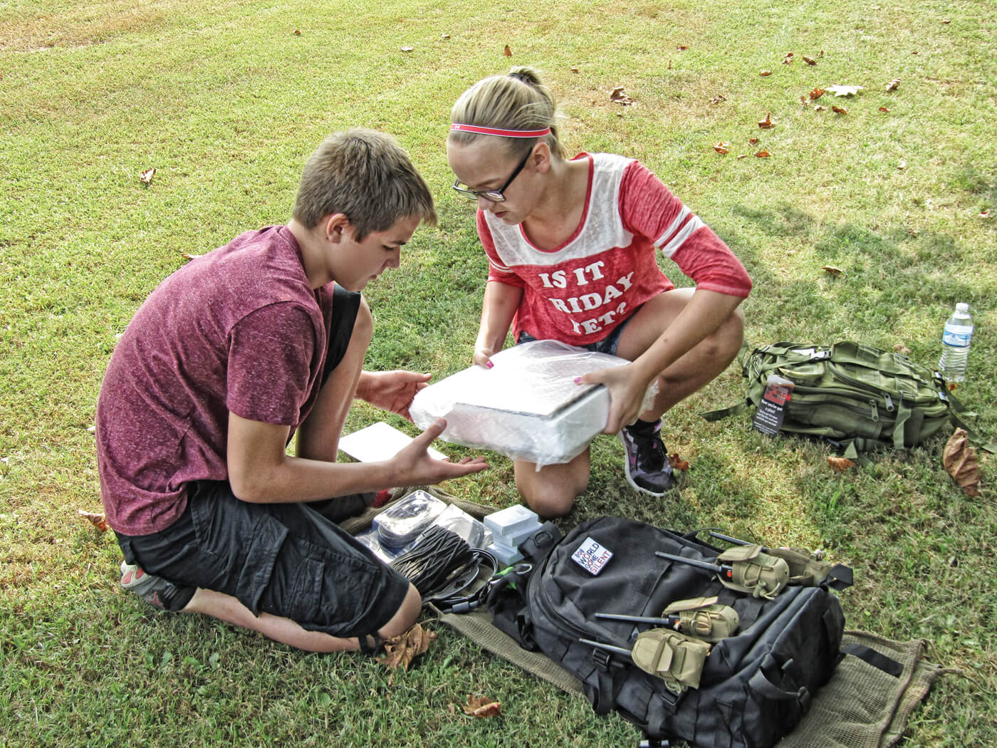 Young girl and boy preparing to set up disaster radio repeater pack