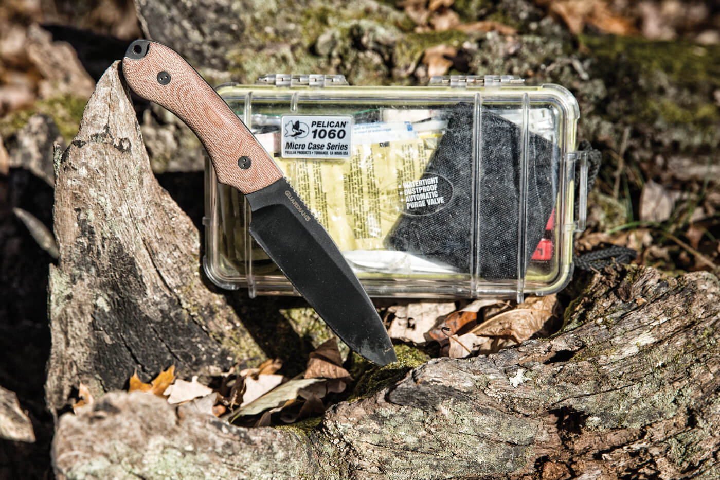 Guardian5 knife shown with a survival kit