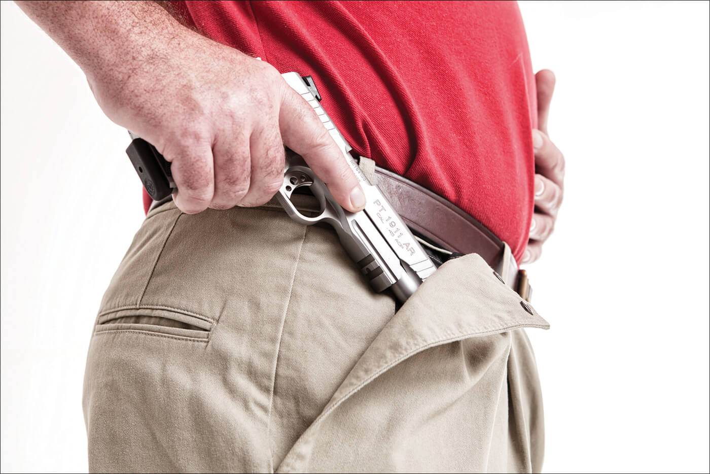 CCW Breakaway pants showing how a 1911 pistol can be concealed in its secret flap