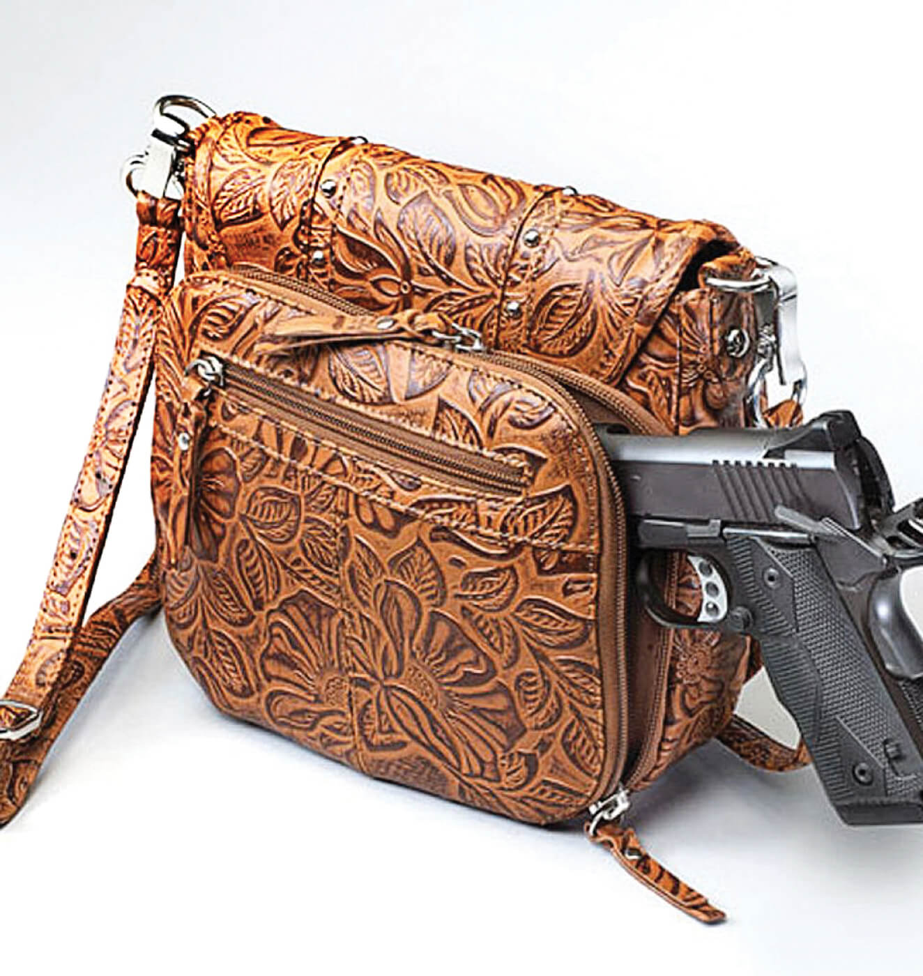 Roseleaf-patterned tote bag for women with 1911 pistol emerging from concealed carry compartment