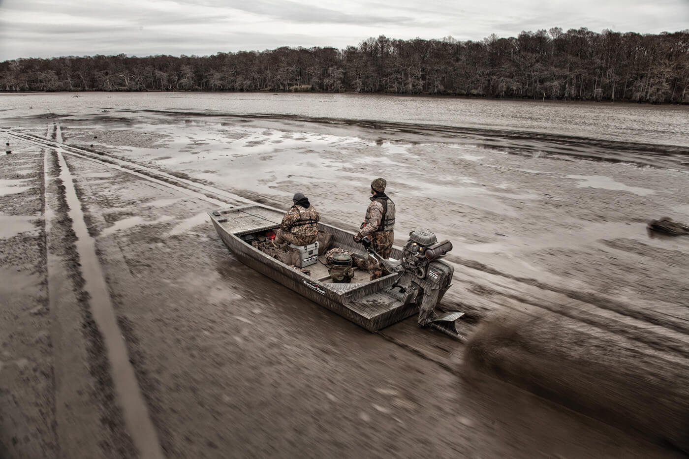 Gator-Tail watercraft speeding through mud bog