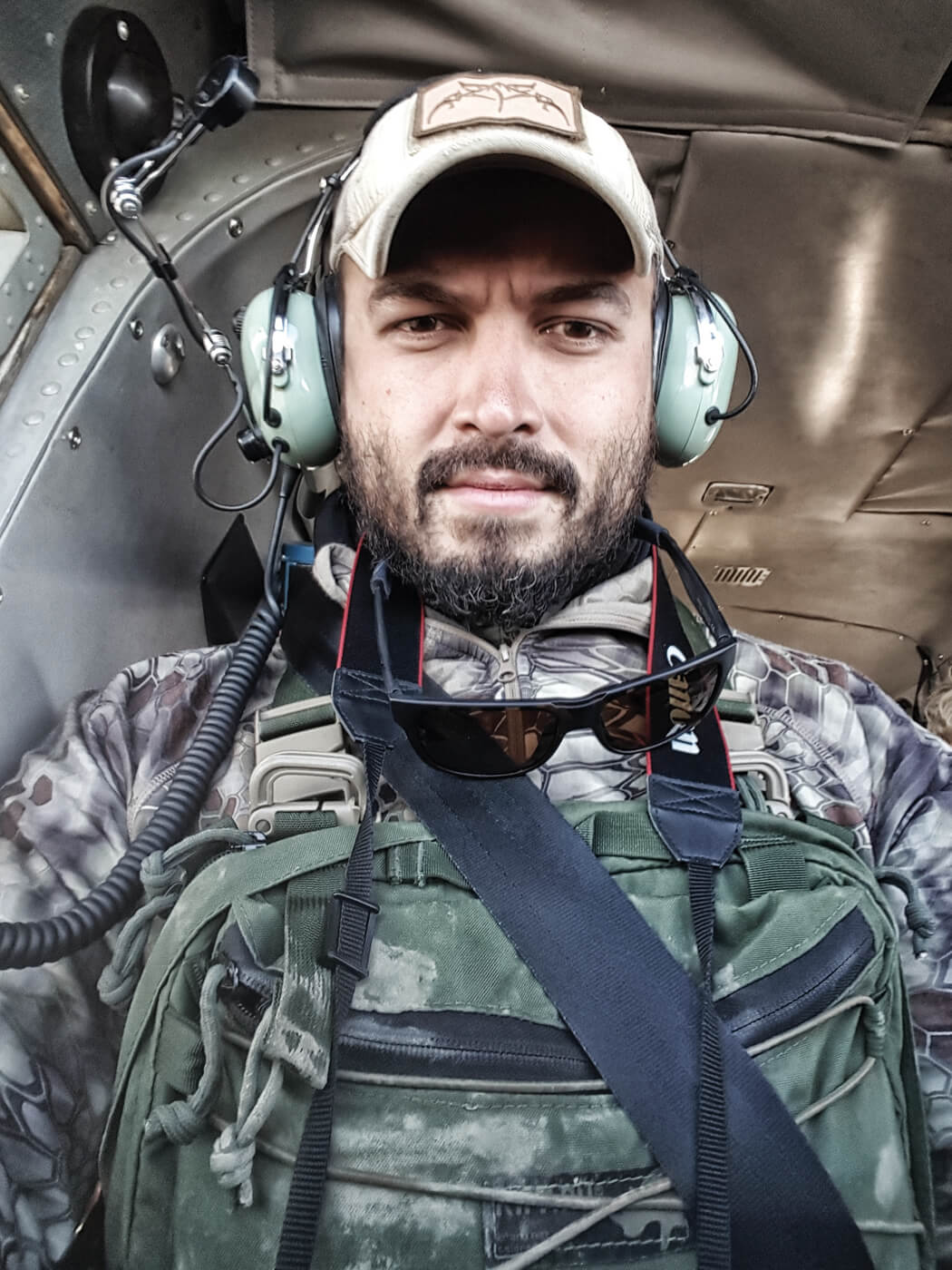 Man wearing Kifaru Koala Lite chest rig while riding in a helicopter