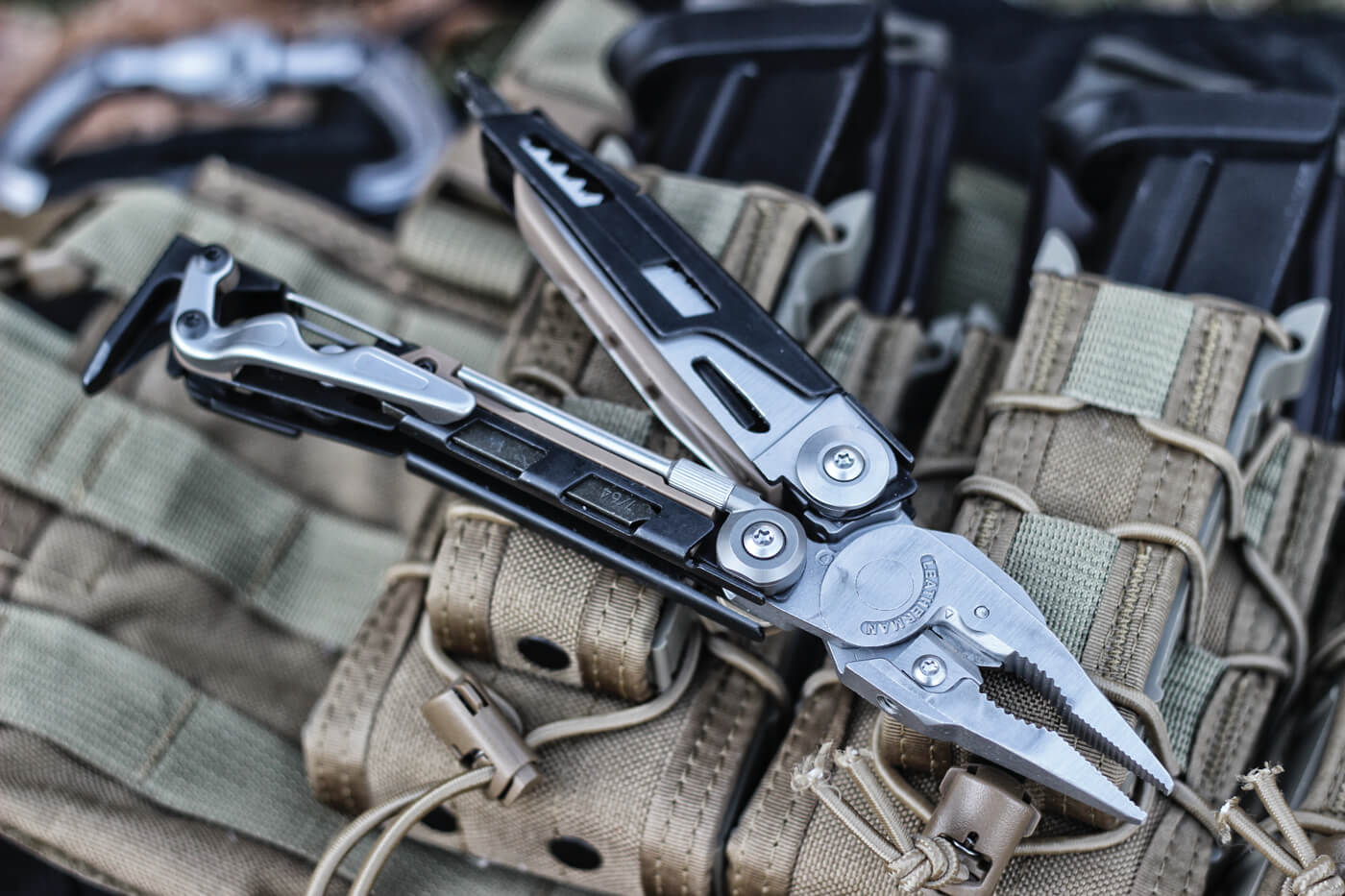 Close-up shot of Leatherman multi-tool, chest rig and spare magazines