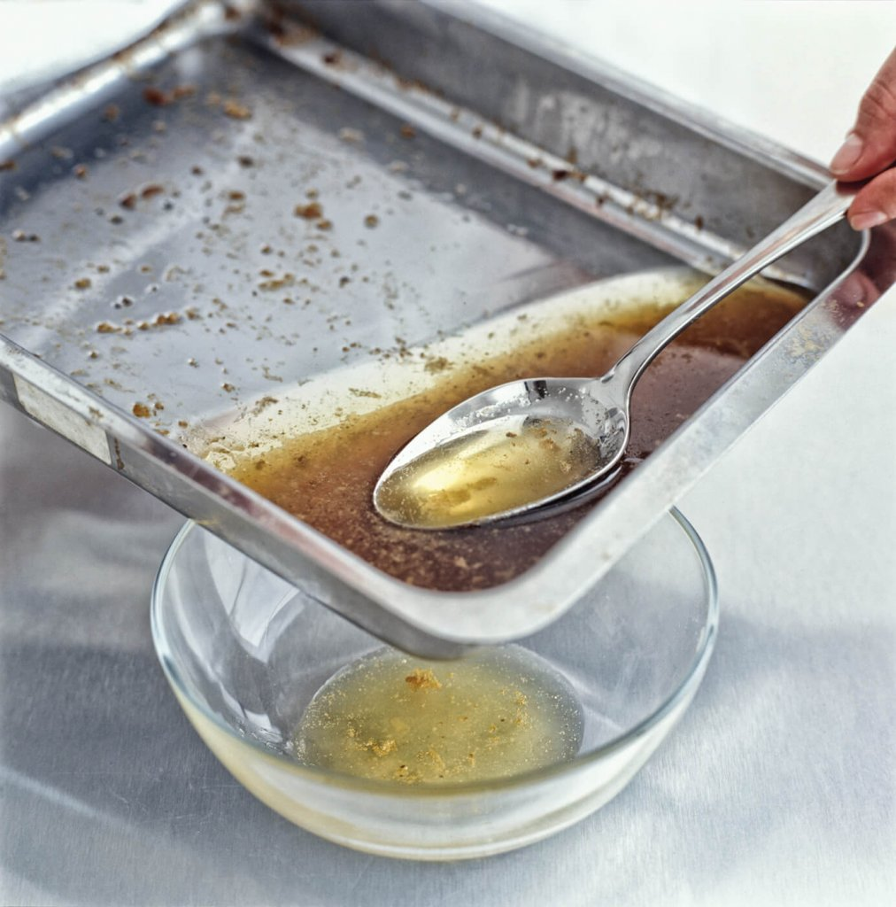 Fat grease dripping from a pan that can be used to make soap