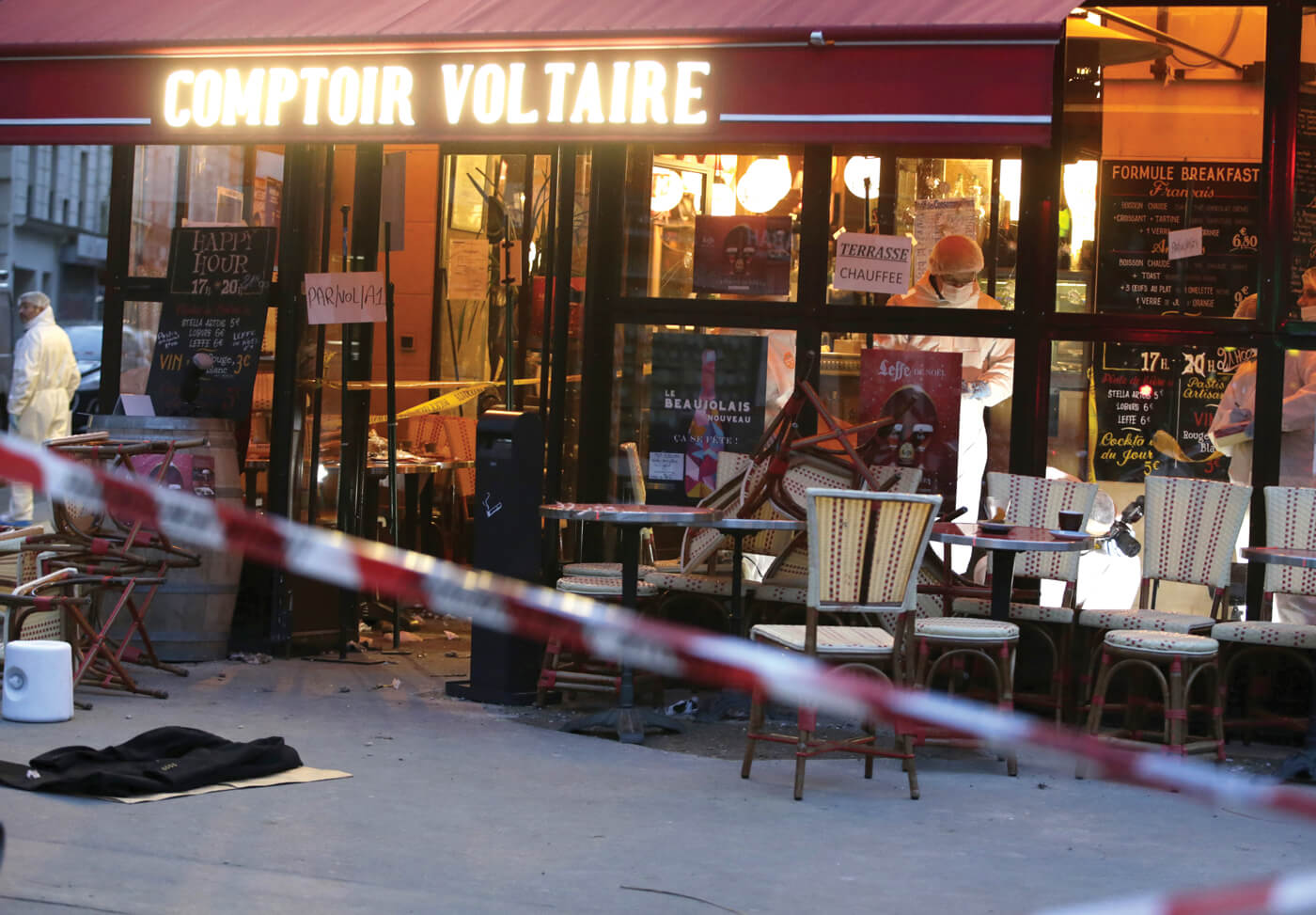Forensic police search for evidence inside the Comptoir Voltaire café at the site of an attack on November 14, 2015, in Paris, after a series of gun attacks occurred across the city. (Photo: Kenzo Tribouillard/ AFP/Getty Images)