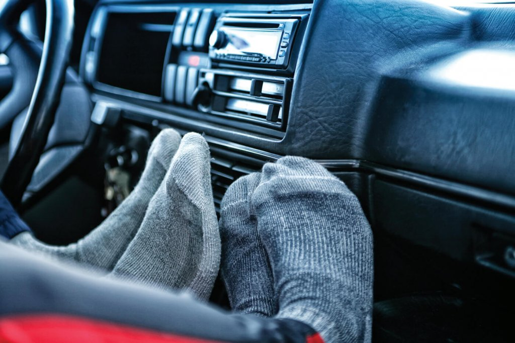 Feet being warmed by car heater