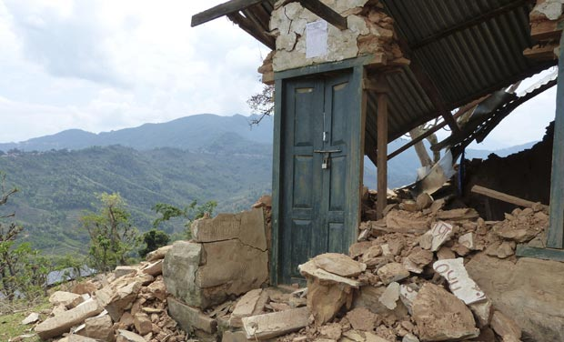 Standing locked doorway in mud brick house after 7.9-intensity quake hit Nepal