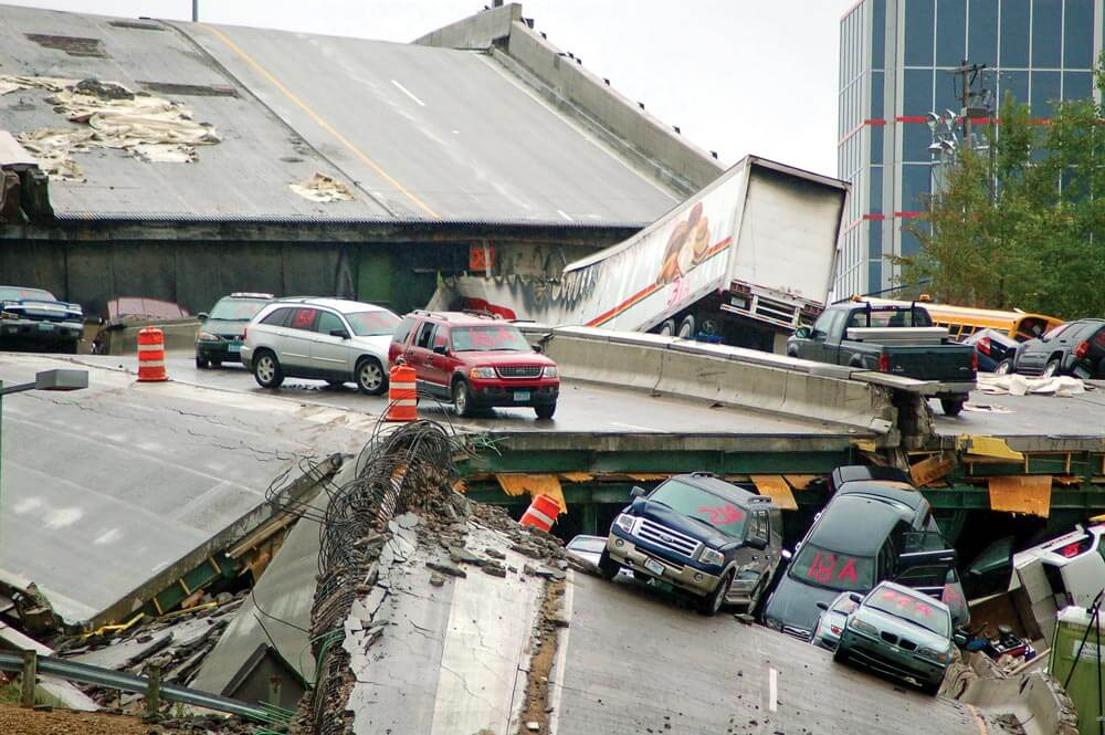 This bridge, destroyed in an earthquake, will throw your route planning entirely out the window, so having alternative routes is critical to the success of your bug-out. (Photo: WikiMedia.org)