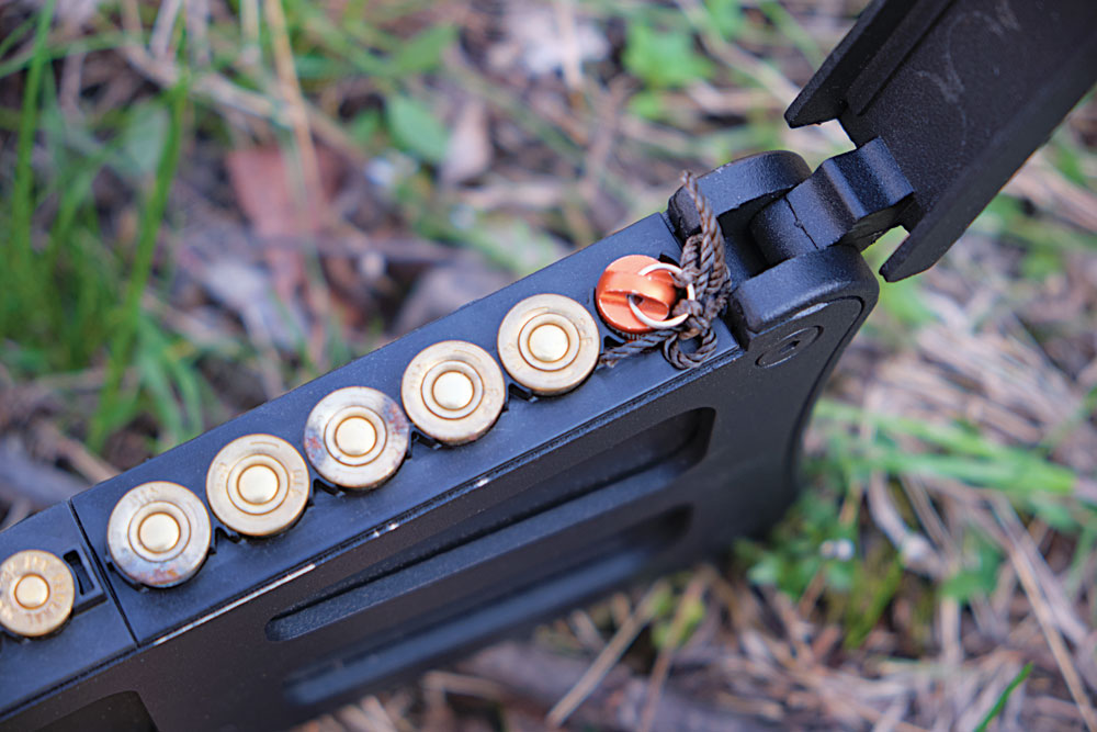 The Exotac nanoSTRIKER XL ferro rod fits perfectly in a .410 ammo compartment in the stock of the rifle.