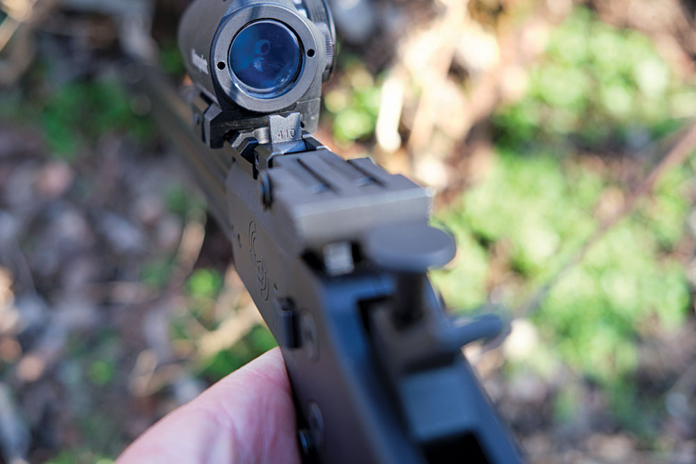 The .410 sight is a shallow V-notch that's easily flipped up when needed.