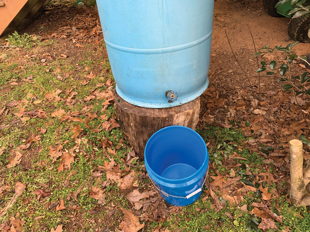 place your rain barrel on top of, such as a large stump or a few stacked cinder blocks.