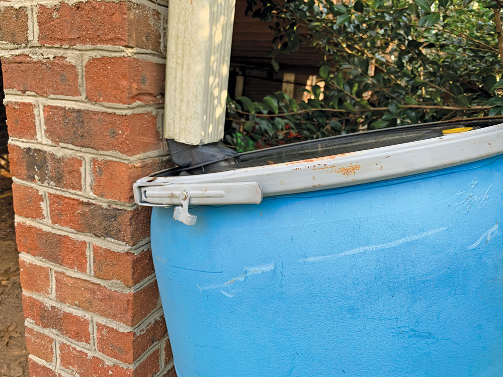 Put the rain barrel in place, positioning the waterspout junction directly into the downspout.