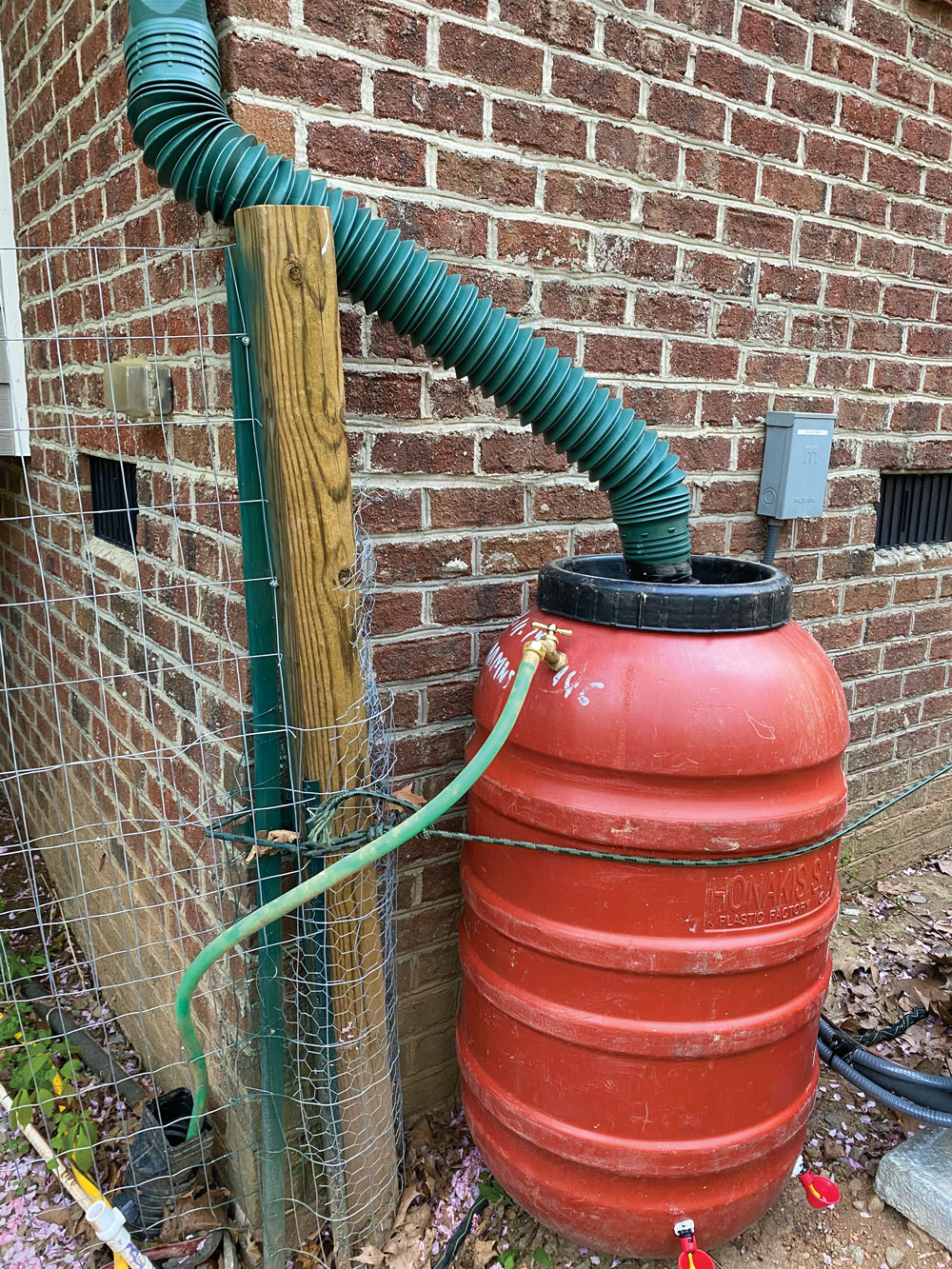 This installation shows a long, flexible downspout adapter