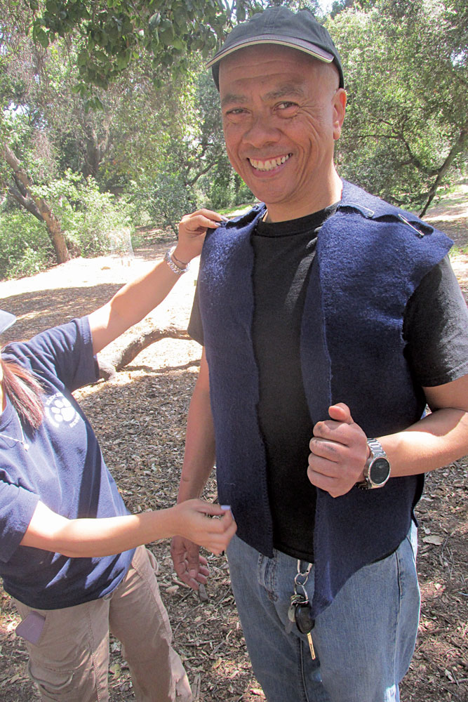 Students learn how to make a simple vest.