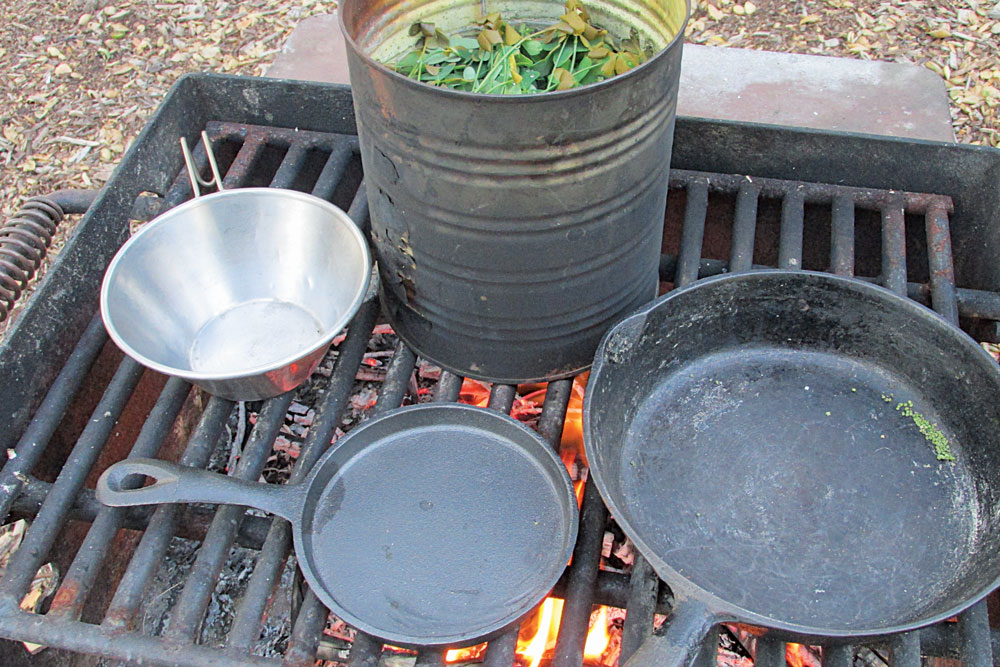 "The author's simple ""mess kit"" often includes a small cast-iron skillet and a can."