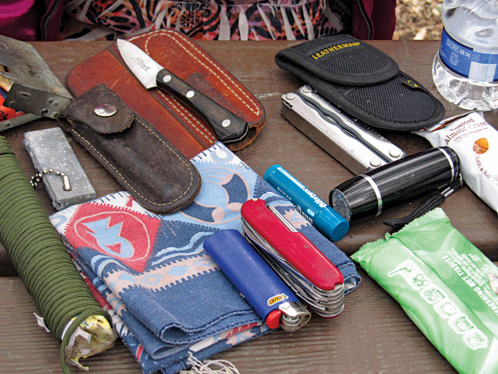 A variety of ordinary and functional basic gear, such as paracord, knives, a flashlight and other basics