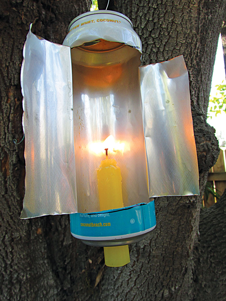 A simple, yet functional, lantern can be made from an old drink can and a candle.