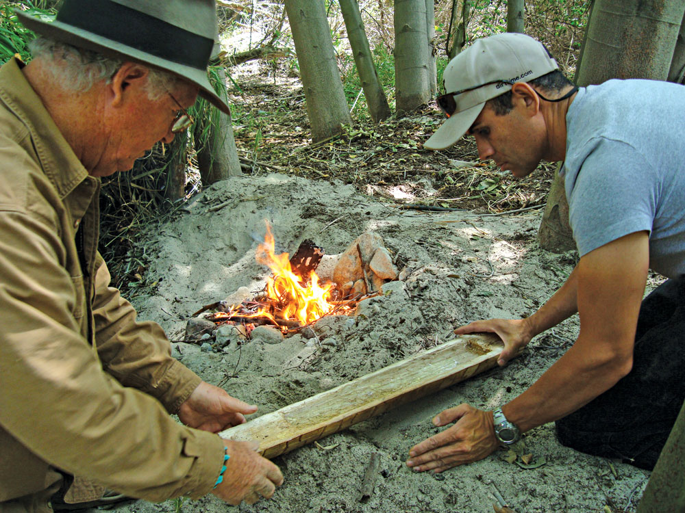 Here, instructors Dude McLean and Alan Halcon prepare to cook in a hollowed-out yucca stalk.