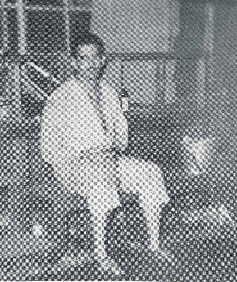 Boehm takes a much-needed rest on a bench in front of the Suzuki household.