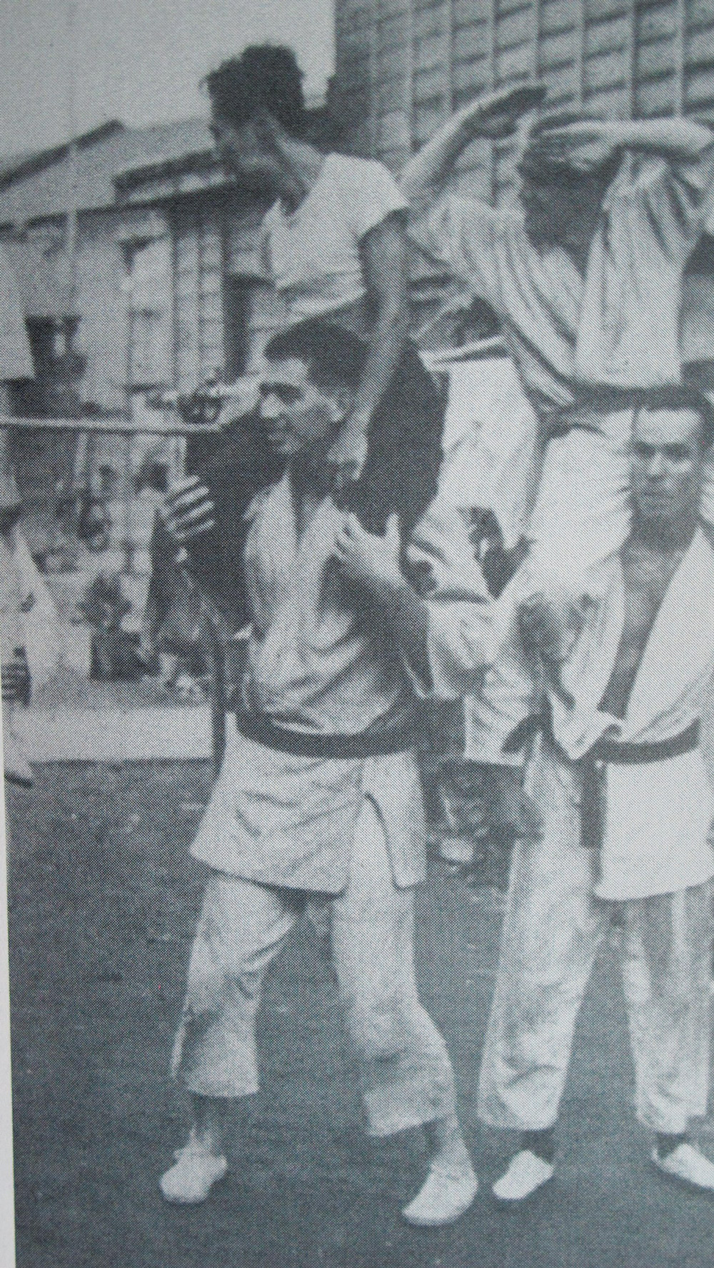 Master Suzuki is seated on Boehm's shoulders while in a group of some of Boehm's Navy buddies, who also trained with Suzuki.