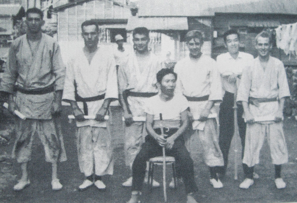 Master Suzuki is seated at the front, center. Boehm stands at the far left, along with some of his Navy buddies.