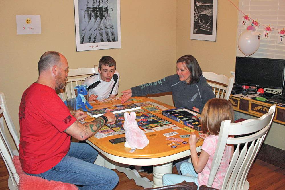 Some good, old-fashioned board games helped distract and amuse the author's clan.