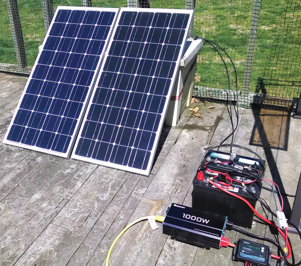 The author's solar generator setup for the refrigerator test. An extension cord ran from the Renogy 1,000-watt inverter to the kitchen