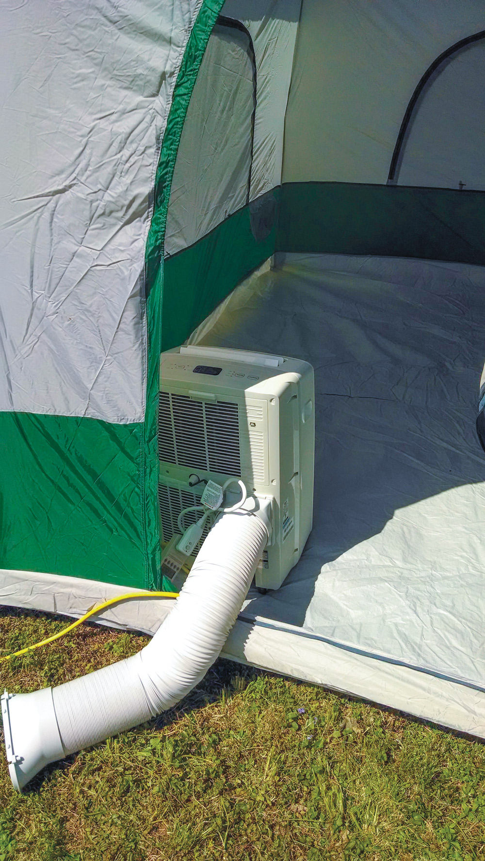 An 8,000 BTU portable air conditioner that was set up inside a tent for testing on a hot day provided a good test of the Renogy 1,000W.