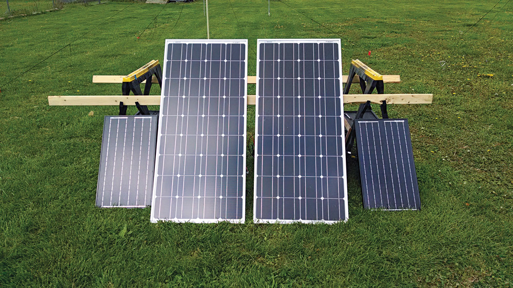 Two 100 Ah deep-cycle batteries, along with 260 watts of solar input, ran the author's air conditioner for two hours straight before the batteries discharged to 50 percent.