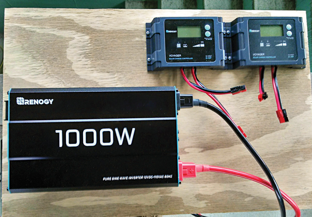Here, the Renogy 1,000W Pure Sine Wave Inverter is mounted on a plywood board, along with a pair of Renogy Voyager 12-volt, 20-amp charge controllers that are the core components of the author's solar power generator.