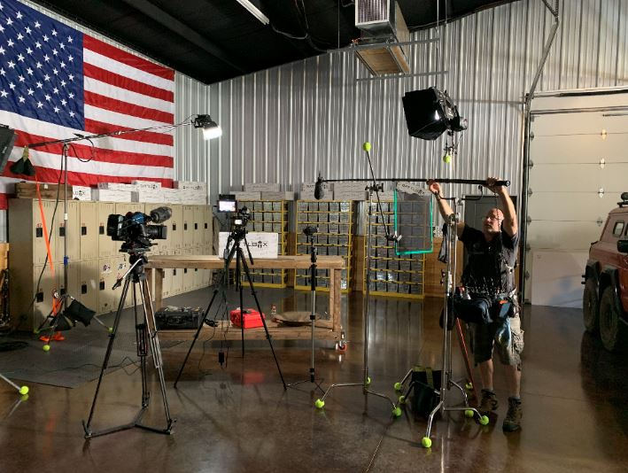 Behind the scenes of Southern Survival with the American flag proudly displayed nearby