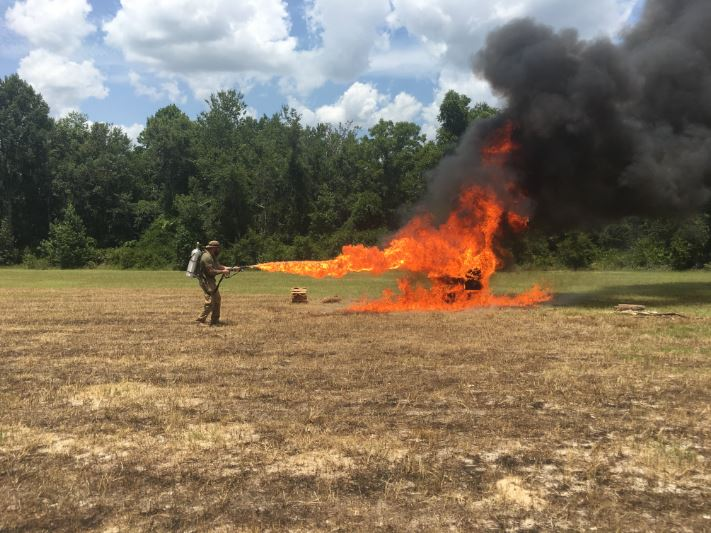 You need a lot of land to use a flame thrower. Just ask the operator, Brandon Currin.